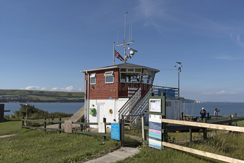 Lookout point on the southern coast of UK. Lookout station of the National Coastwatch Institution manned by volunteers at Peveril Point on the Jurassic coast at stock image