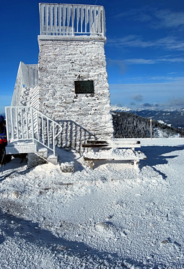 Lookout on Pretulalpe in Fischbacher Alpen mountains. Stony lookout covered by ice on Pretulalpe hill near Roseggerhaus chalet in winter Fischbacher Alpen stock images