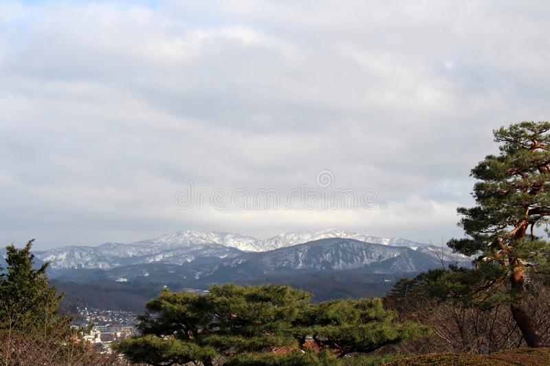 The lookout spot from Kenrokuen, one of the most beautiful gardens in Japan. The view around Kenrokuen, one of the most beautiful gardens in Japan. Taken in royalty free stock photo