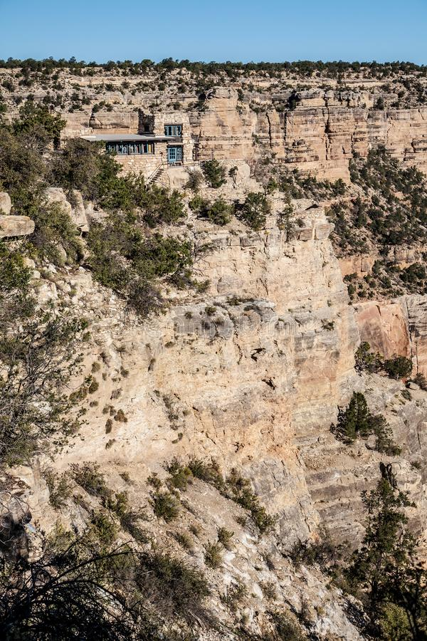 Lookout Studio at The Grand Canyon. Vertical image of the historic Lookout Studio, designed by architect Mary Coulter in 1914, is a rustic structure built on a stock photo
