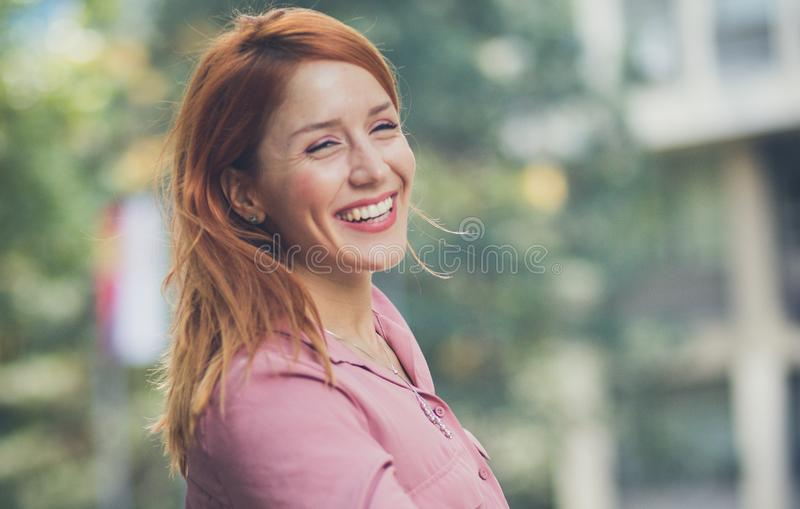 This looks like a happy and successful woman. royalty free stock images