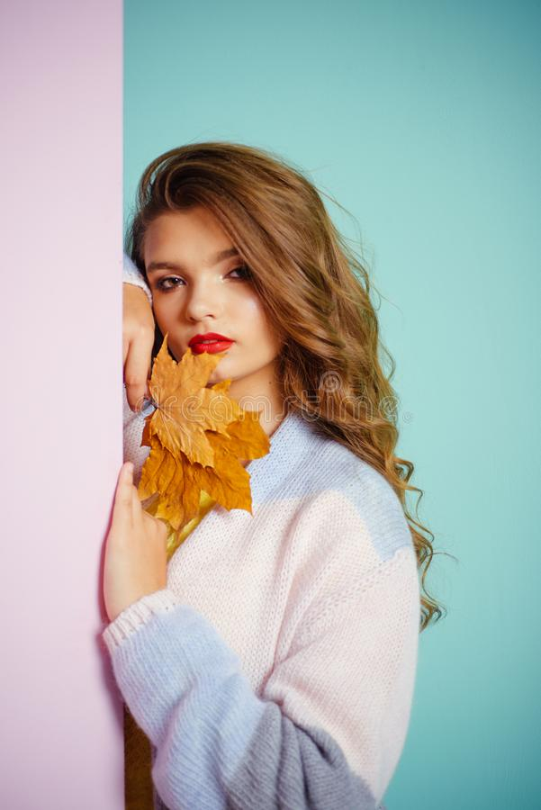 She looks perfectly groomed. Visage model with decorative fall makeup. Pretty girl hold autumn leaves. Adorable fall. Look. Makeup girl. Make-up trends for royalty free stock image