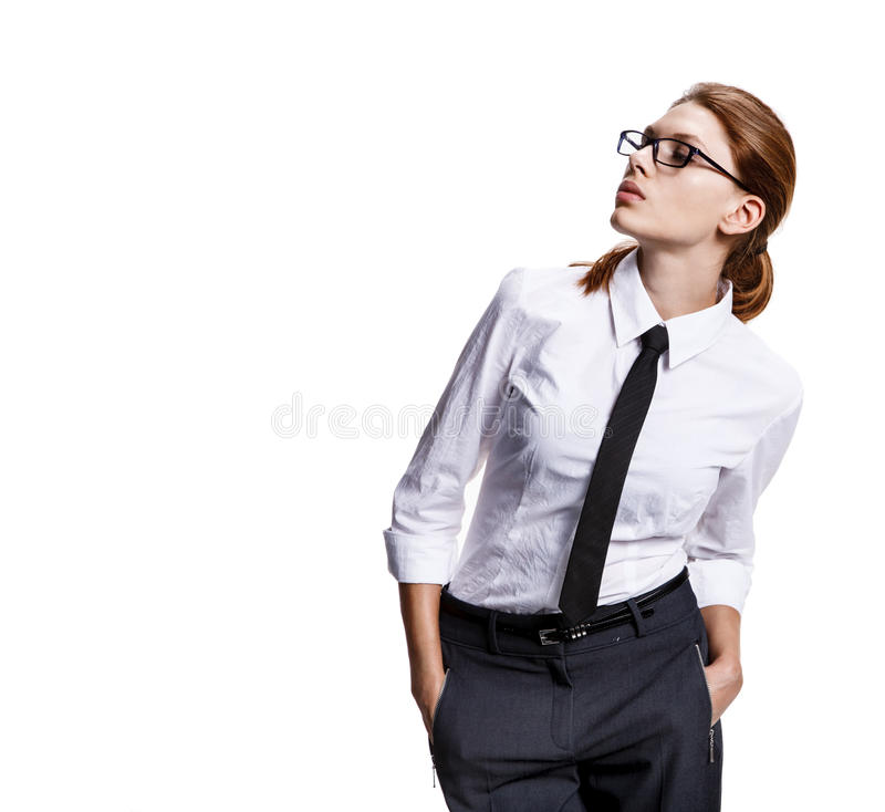 Looks towards. Studio shoot of strict woman with her hands in pockets - isolated on white background royalty free stock image