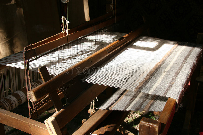 Loom. A loom of a weaver in hard lighting stock images
