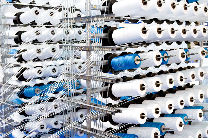 Loom. Spools of thread on a loom royalty free stock images