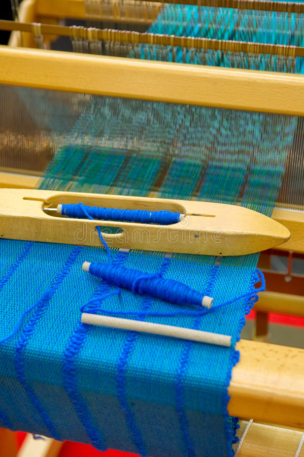 Loom. A Loom with blue fabric royalty free stock image
