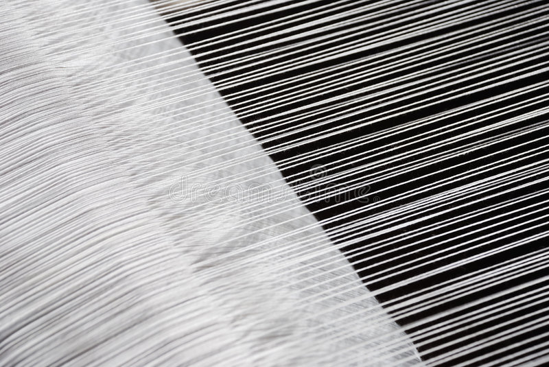 Loom. Part of loom, white thread, homemade, horizontal royalty free stock photography
