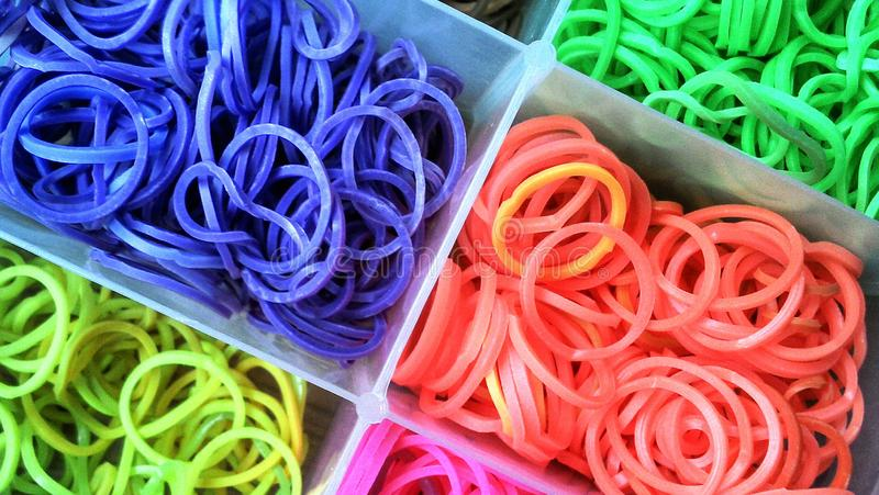 Loom bands. Various coloured loom bands organized in a box royalty free stock image