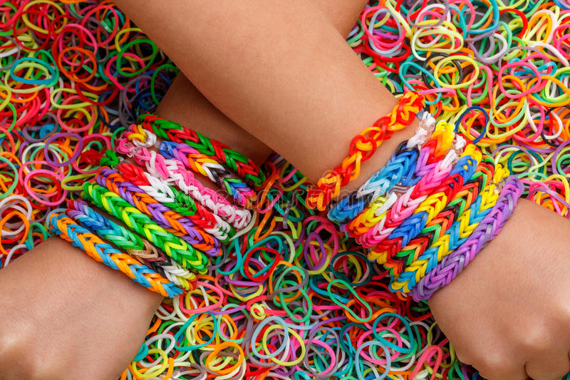 Loom bracelets. Colorful rubber in background stock photos