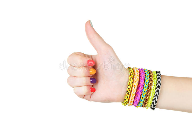 Loom bracelets. On hand of young girl, showing thumbs up royalty free stock photography