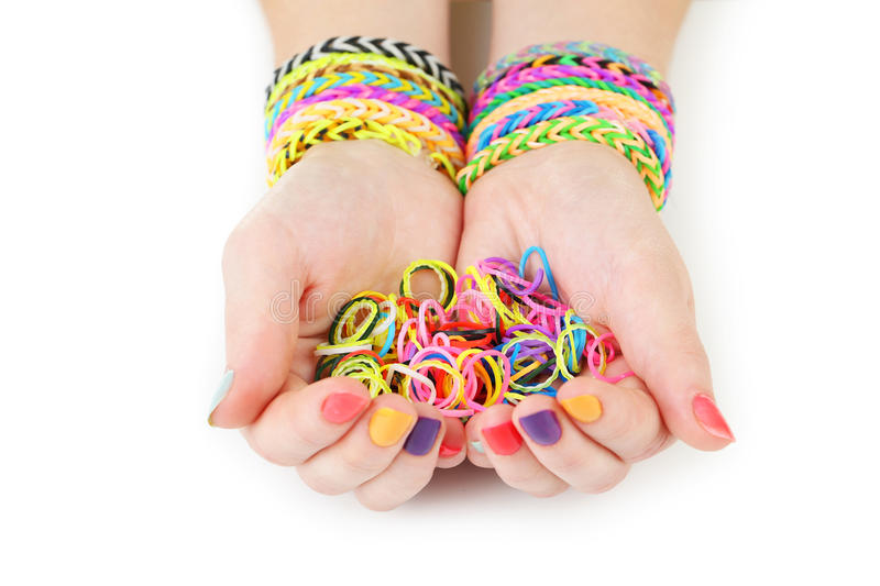 Loom bracelets. On hands of young girl stock image