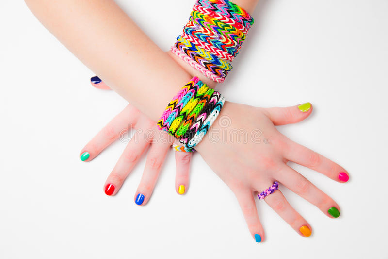 Loom bracelets. On a young girl's hand. Close up. Young fashion concept stock images