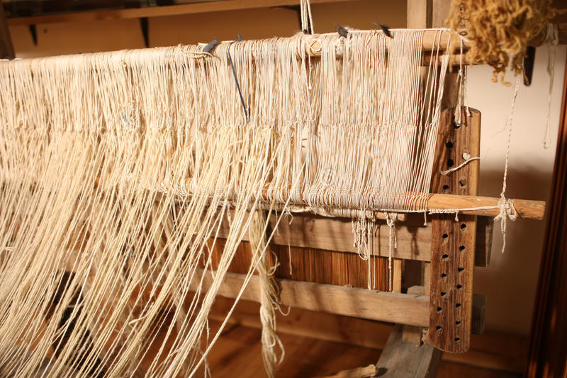 Loom. Classic asian loom at work royalty free stock images