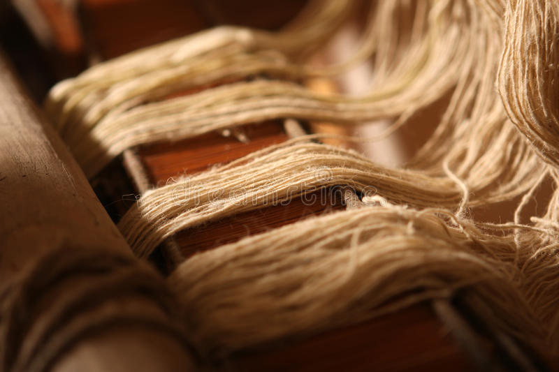 Loom. Classic asian loom at work, close-up view stock photography