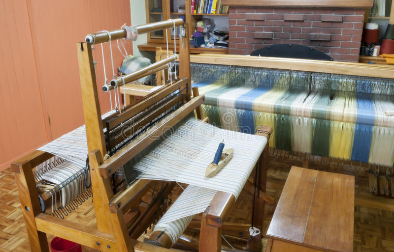 Loom, craft room , old textile techniques. Craft room with a loom royalty free stock image