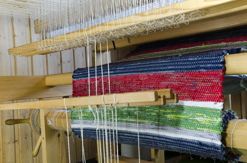 Loom. How the carpet is wraped uop on the bar in a loom, picture from the North of Sweden stock photography
