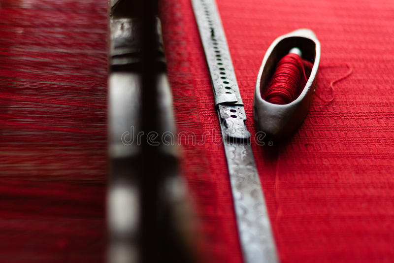 Loom. Vintage old retro loom with red strings stock image