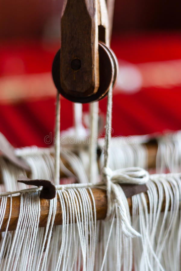 Loom. Vintage old retro loom with white strings stock photo