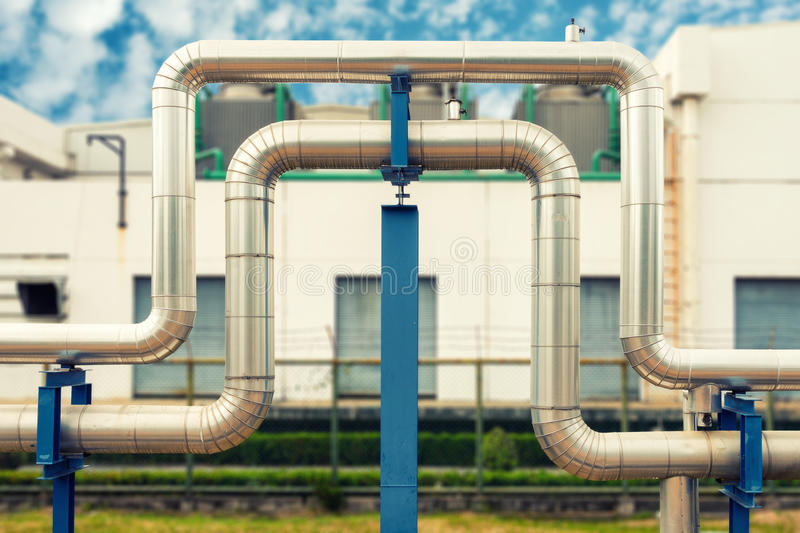 Loop steam pipeline on cooling tower background., Steam pipe insulation. stock photos