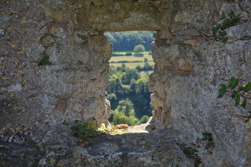 Loophole in old castle wall royalty free stock photo