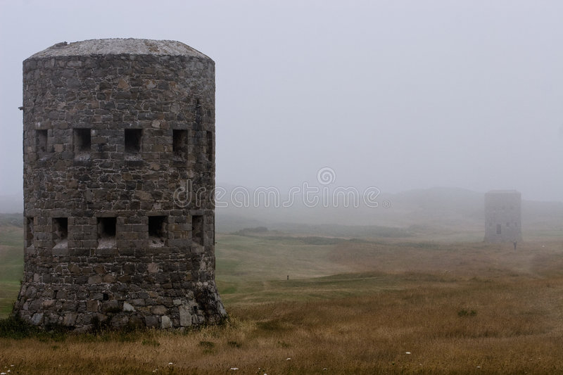 Loophole tower in the fog stock photos