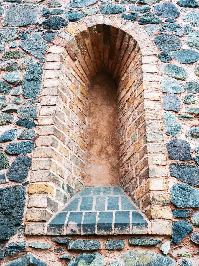 Loophole in wall of medieval castle royalty free stock photo