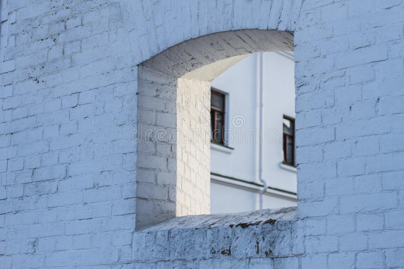 Loophole window in wall of old building royalty free stock image