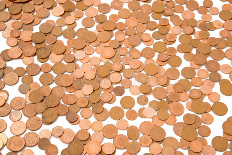 Loose Bronze Coins. Description: A scattered assortment of bronze loose change Location: Corsham, Wiltshire, UK royalty free stock photos
