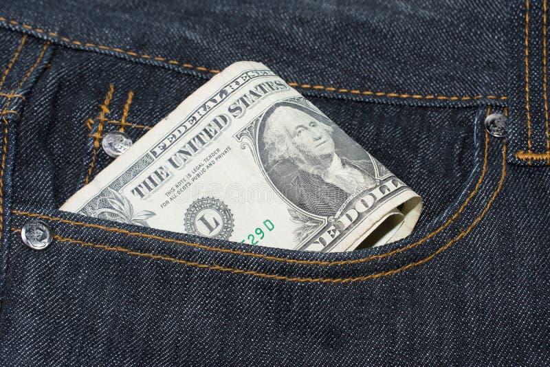 Loose Change Pocket Money Concept. American Dollar Bills stock photography