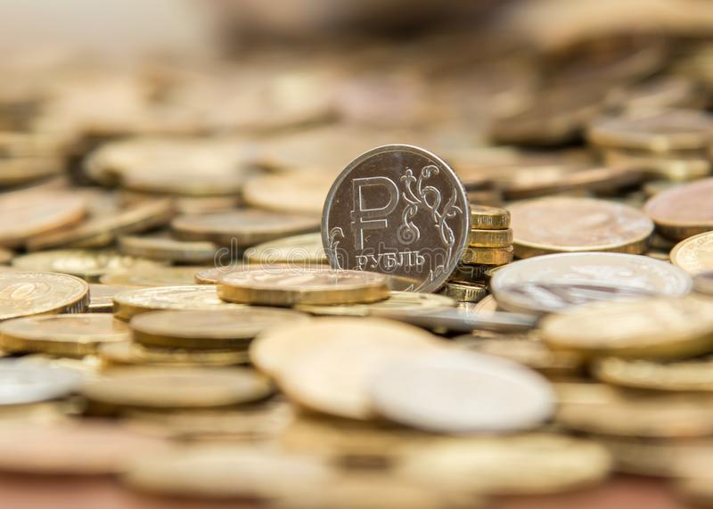 Loose coins on the table and they are worth Ruble. Lots of coins on the table stock image