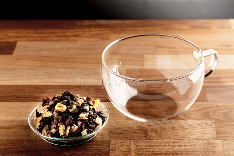 loose tea and empty glass tea cup stock photos