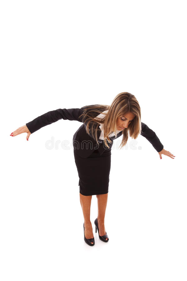 Loosing her balance stock photos