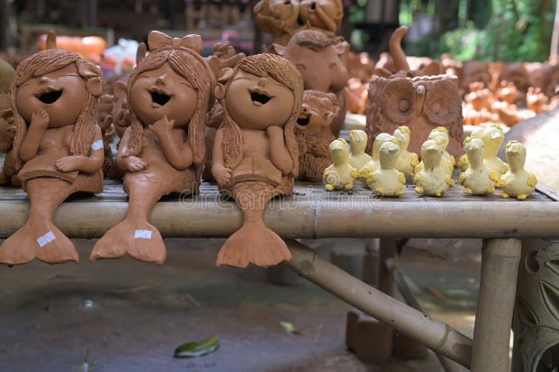 Lopburi, Thailand - November 2, 2019: Community Ban Din Mot Daeng Market.Mermaid and little duck made by clay.  stock photo