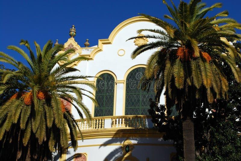 Lope de Vega teater och palmträd, Seville, Spanien royaltyfri bild