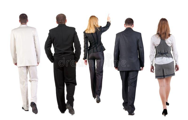 Lopende groep commercieel team. achter mening stock afbeeldingen