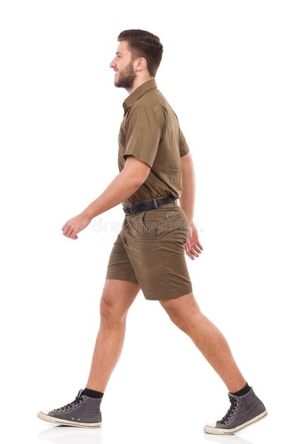 Lopende mens in kaki eenvormig royalty-vrije stock afbeeldingen