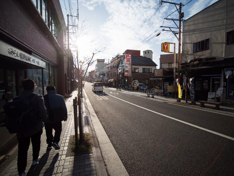 Lopende straat, Yufuin, Yufu Japan stock foto's
