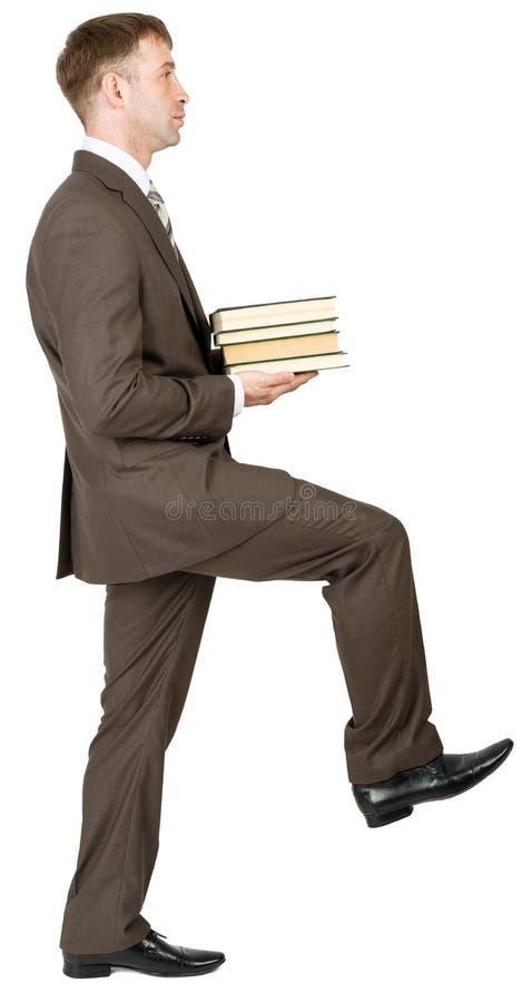 Lopende zakenman met boeken royalty-vrije stock foto's