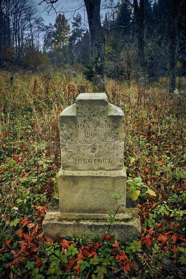 LOPIENKA, POLAND - NOVEMBER 03, 2018: Grave in the old Lemko cemetery in the Bieszczady mountains Poland on a misty autumn day royalty free stock photography