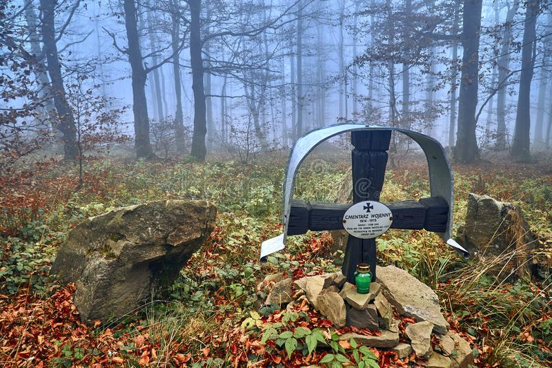 LOPIENKA, POLAND - NOVEMBER 03, 2018: A monument in the forest to the victims of World War I in the Bieszczady mountains (Poland). On a misty autumn day stock images