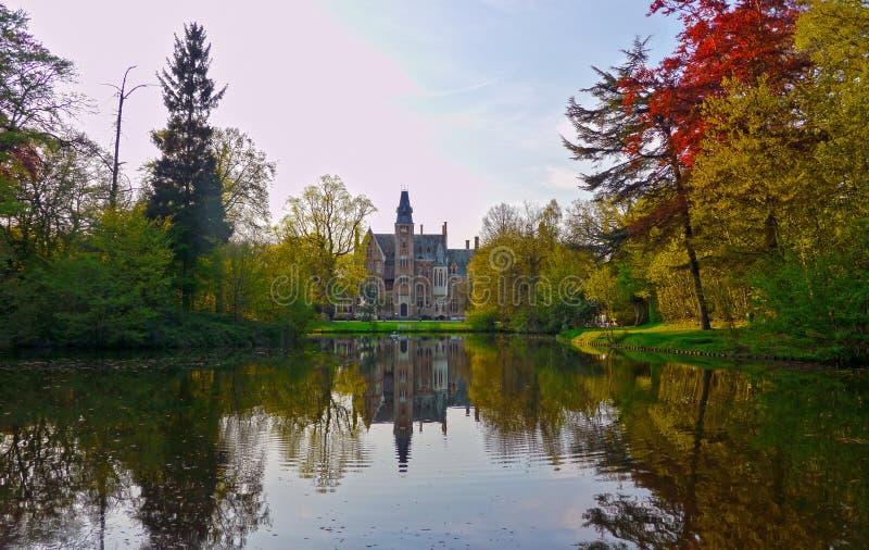 The Loppem Castle, West Flanders / Belgium. Zedelgem, West Flanders / Belgium - May 2013: The Loppem Castle seen through the lake stock photos