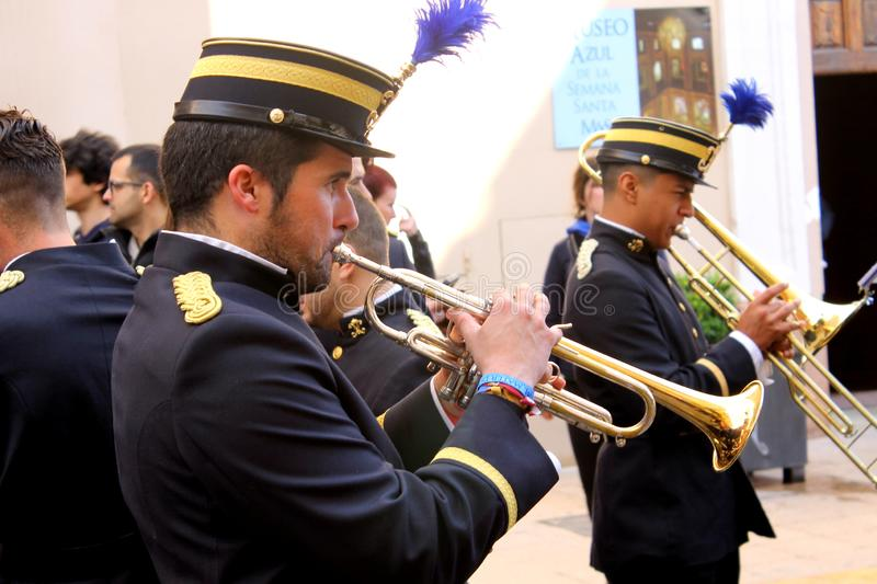 Trumpeters testing and rehearsing their musical instruments during Easter Holidays in Lorca  City. Lorca, Murcia, Spain; on April 26, 2019: Trumpeters that royalty free stock images
