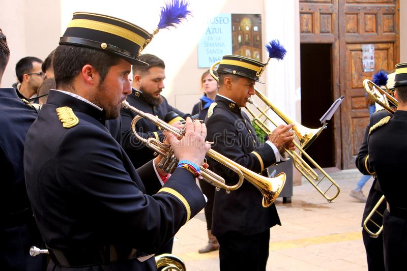 Trumpeters testing and rehearsing their musical instruments during Easter Holidays in Lorca  City. Lorca, Murcia, Spain; on April 26, 2019: Trumpeters that stock photo