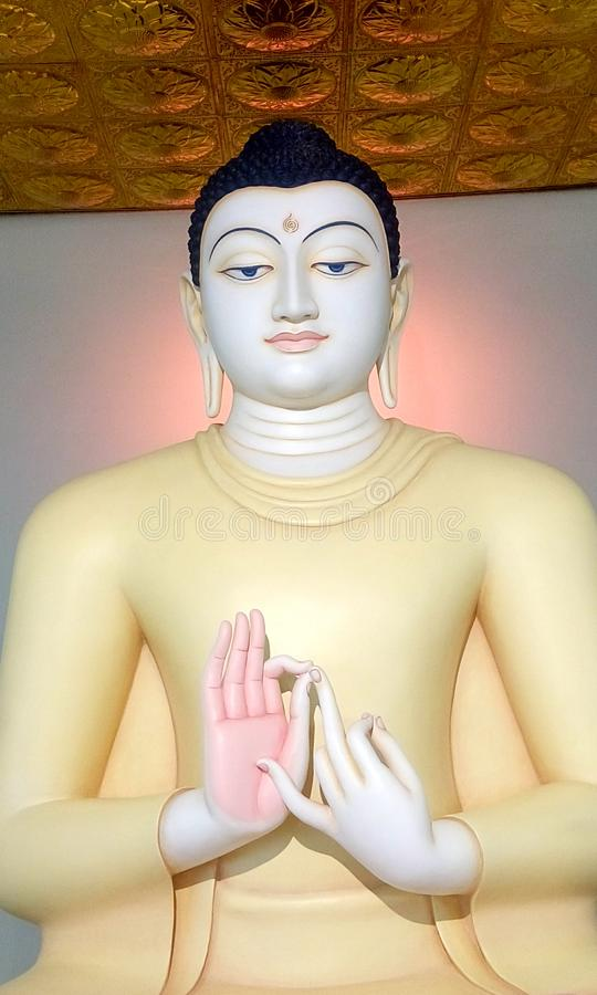 Lord buddha statue with sandal color in an airport srilanka stock photos