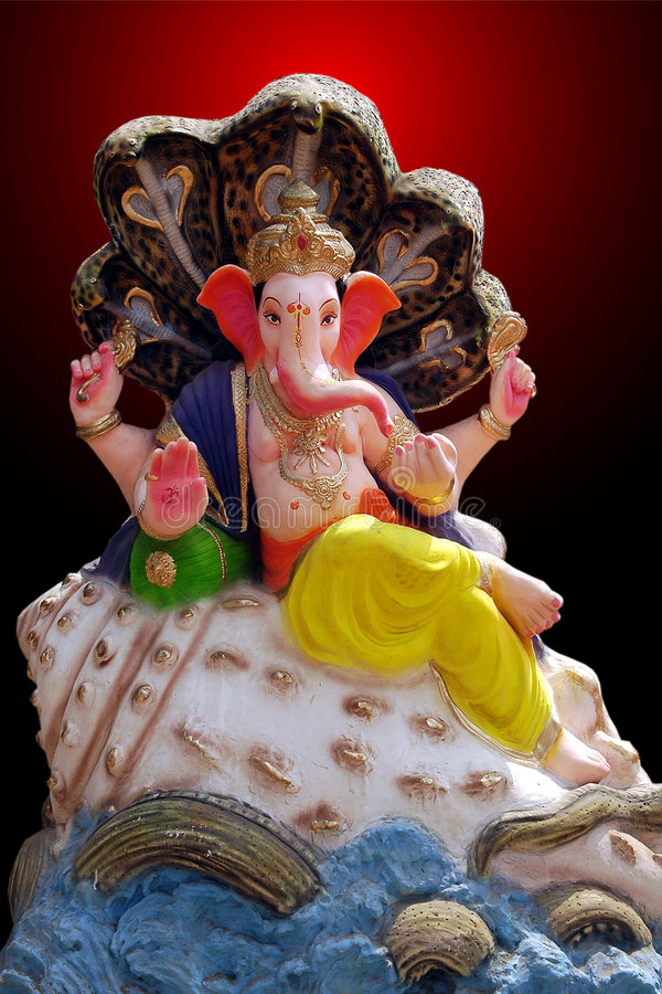 Lord Ganesh in role of Lord Vishnu. Lord Ganesha sitting on a shell in role of Vishnu under the shadow of Snake. This God of knowledge and the remover of stock image