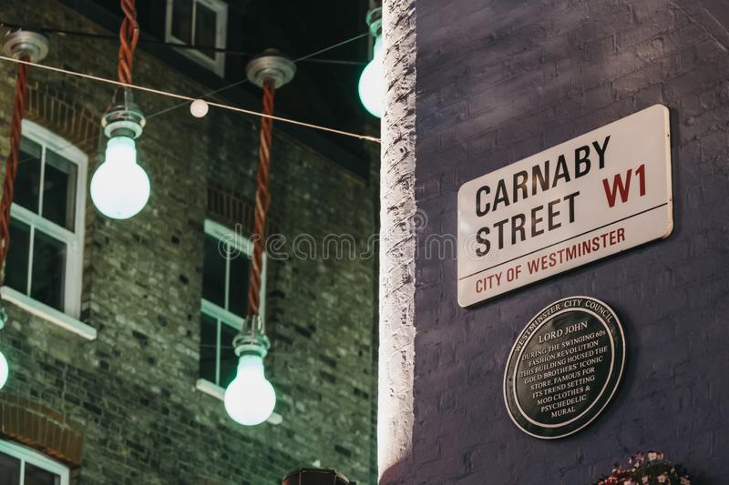 Lord John memorial plaque and street name sign on a wall in Carnaby Street, London, UK royalty free stock photography