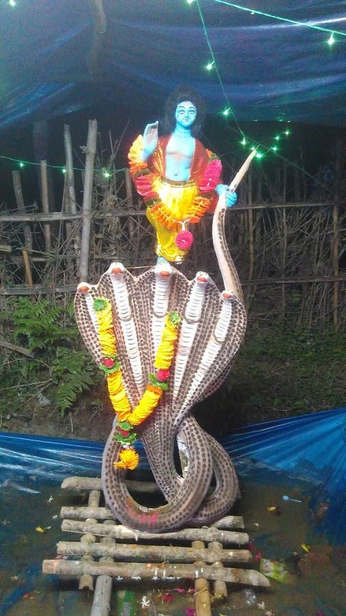 Lord Krishna on the snake royalty free stock photos
