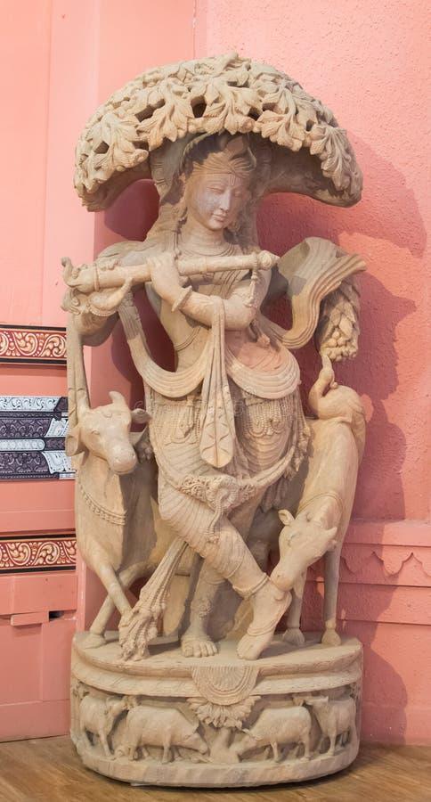 Lord Krishna Idol Playing Flute arkivbild