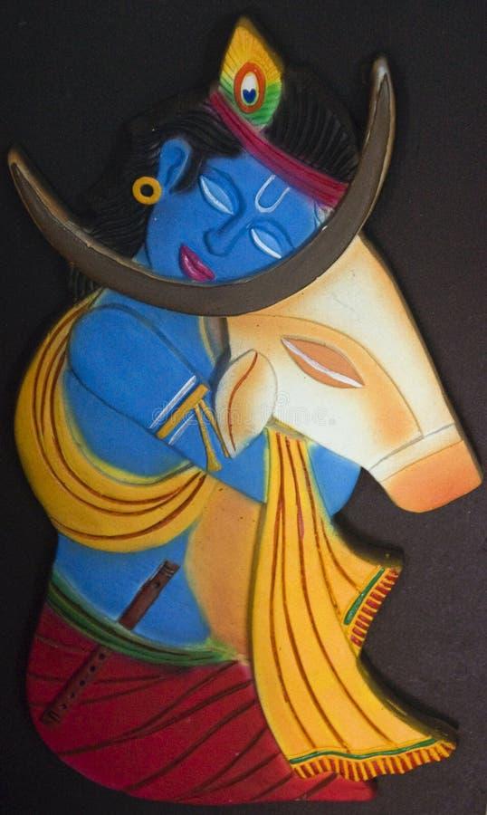 Lord Krishna och kon royaltyfri fotografi