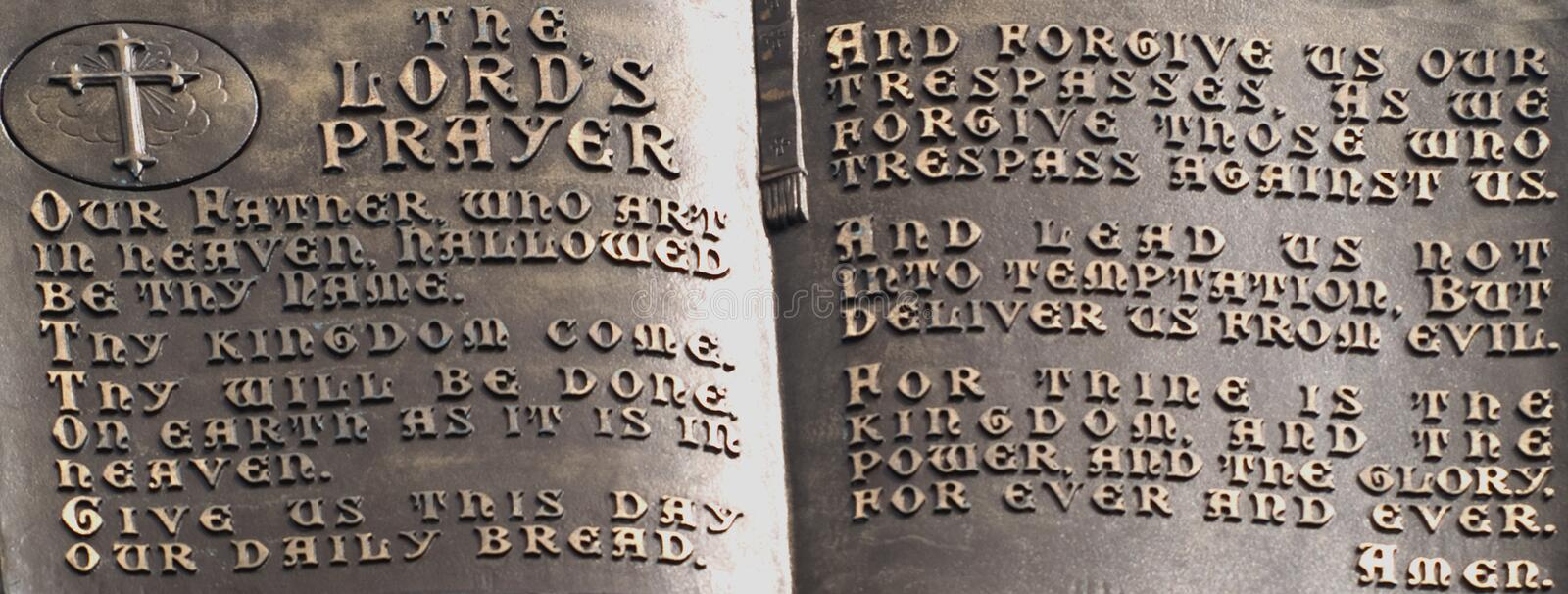 The lord's prayer. Close-up of the lord's prayer on a statue stock photography